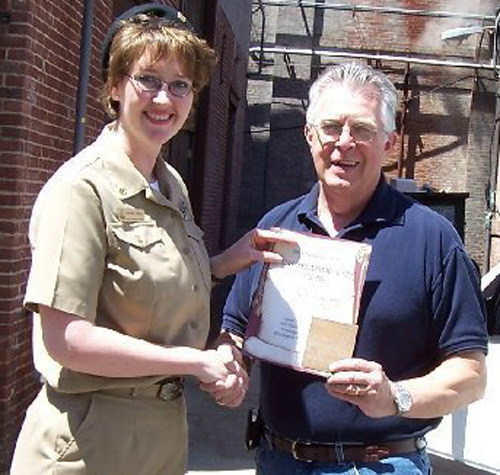 Paul Dillon with a letter certifying the deck planking from the Oklahoma City